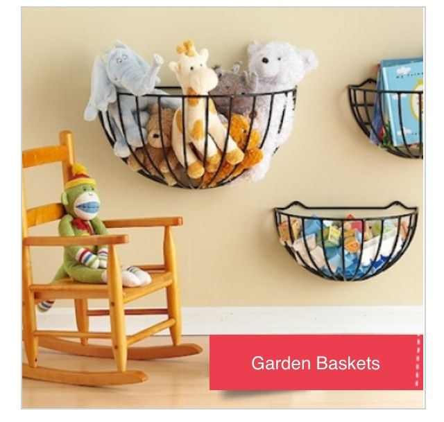 Great way to store stuffed animals! I like how the baskets are low enough so kids can have easy access to them. Very cute idea!