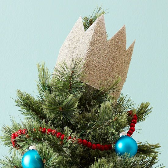 Crown your tree at Christmastime with this easy-to-make tree topper. Measure a strip of paper to fit around the top of your tree. Cut out triangles on one edge to form a crown shape, then secure the paper edges together with a bit of tape or glue. Slip over the top of your tree to give it a royal look.