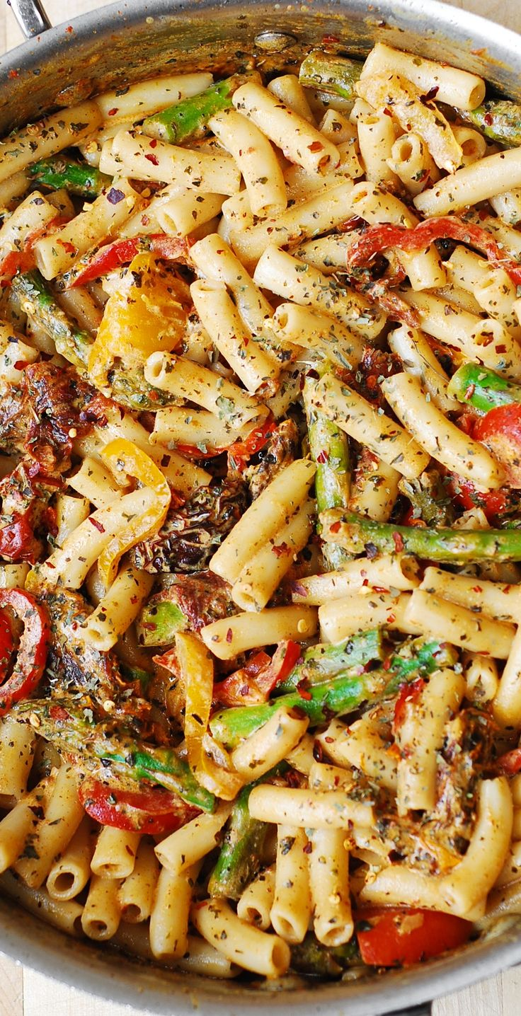 Penne Pasta, Bell Peppers, and Asparagus in a Creamy Sun-Dried Tomato Sauce