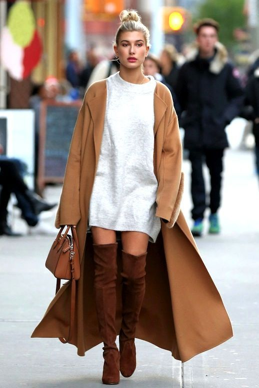 Photo via: Vogue Hailey Baldwin stepped out recently in New York City in an incredibly chic and elevated take on the sweater dress. The It model layered a long camel coat over her grey sweater dress a