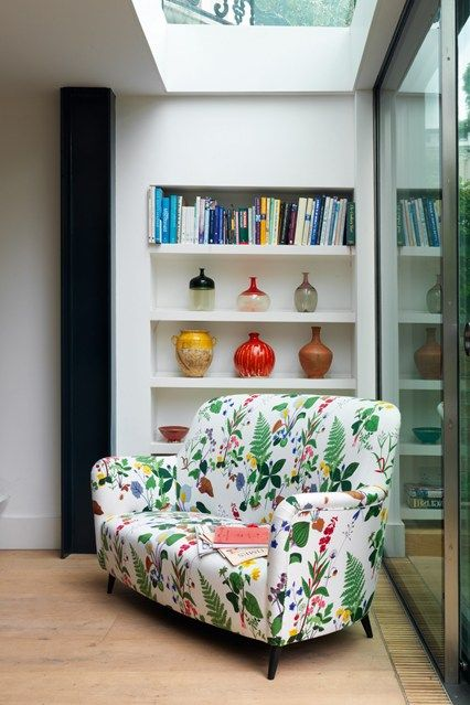 Victorian Terrace Kitchen Corner - Real Homes - Interiors Inspiration (houseandgarden.co.uk) Here and there, touches of vibrant colour accent the clean minimalist lines of the rooms. In the corner of the kitchen, a 50s sofa is covered in 'Dragonfly White' by Jobs Handtryck from Skandium and arrangements of pigment-rich ceramics and glass vessels line the shelves.