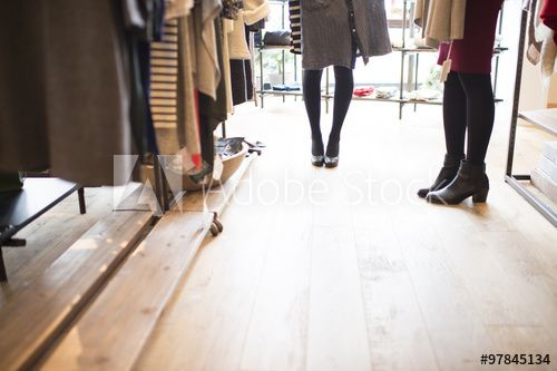 Women are shopping with a friend in a store