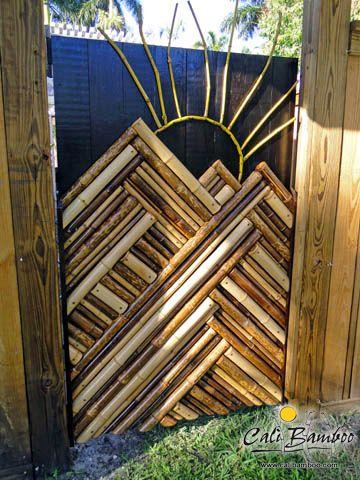 Random bamboo pole scraps used to create outdoor artwork on a garden gate.