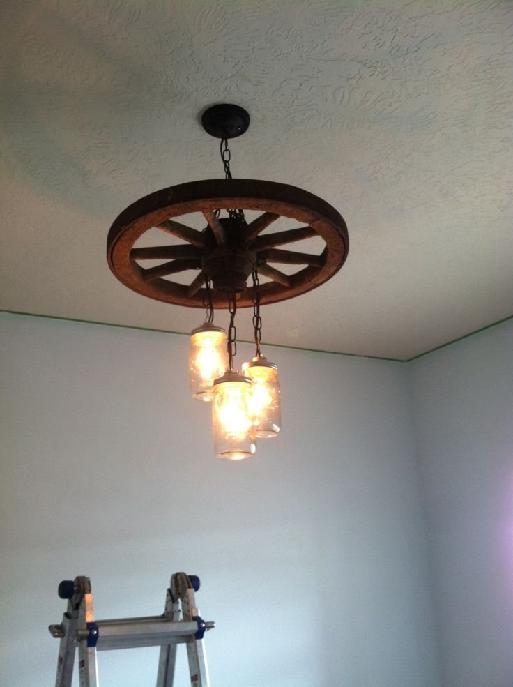 old wagon wheel and mason jar lightchandelier alternating length wagon wheel mason jar