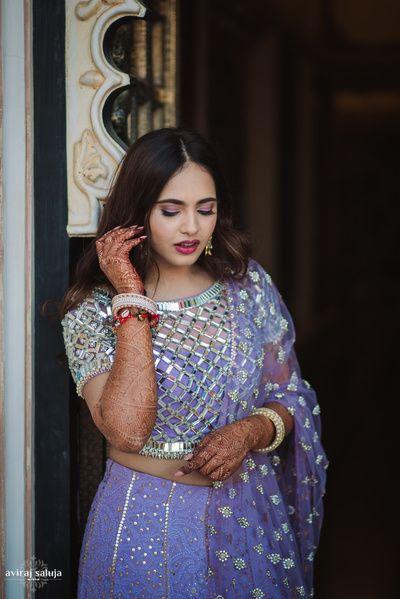 Bridal Details - Silver Mesh Blouse with Lilac Lakhnavi Lehenga | WedMeGood #wedmegood #indianbride #indianwedding #lehenga #lakhnavi #lilac #silver #mesh  Photography by : Aviraj Saluja