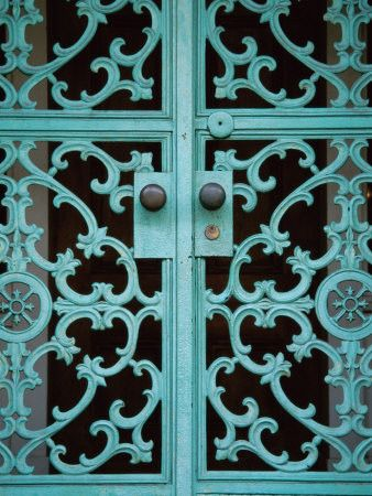 Turquoise scrollwork door, i would love to know what's behind it