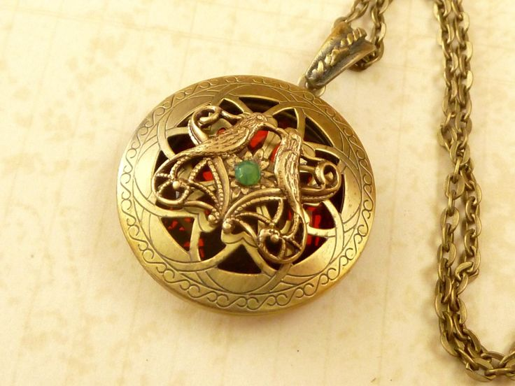 Noble locket necklace in antique style with bird ornament and red-brown gemstone - pinned by pin4etsy.com
