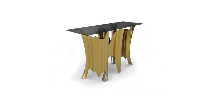OBSSEDIA console by Koket | Initially it is a console. Then it becomes a console cut from clear glass, the top slightly smoked in bronze. Your eyes begin to wander down, drinking in the rhythmic design of the gold plated aluminum base, following every gold crevice leading down only to head back up; compelling you to continue staring. #console #luxurydesign #interiordesign http://www.bykoket.com/guilty-pleasures/casegoods/obssedia-console.php