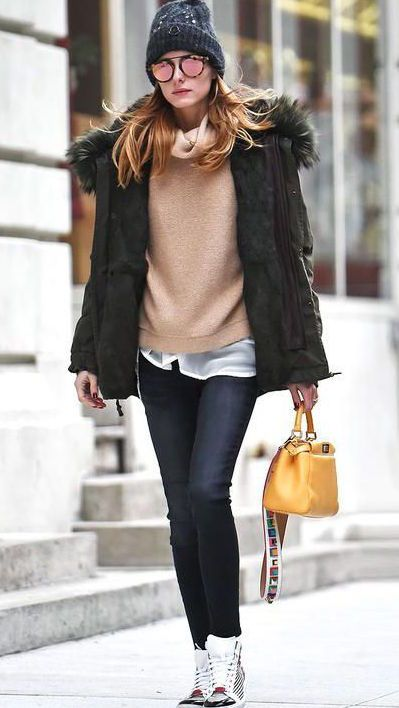 Love this casual winter outfit! Bobble Hat, Faux Fur Coat, Layers and - yes, sneakers! Awesome!