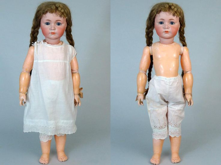 Antique German bisque head doll made by Kammer  Reinhardt ca. 1911. Mold 117 with closed mouth. The doll stands 26.3 (67 cm) tall. Her bisque head is
