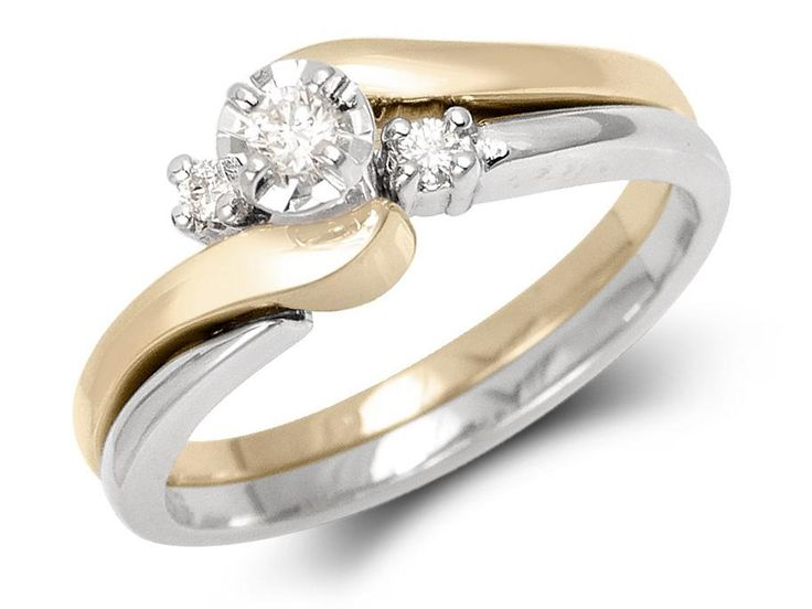 Yellow gold ring with white gold illusion setting and white gold band with 2 diamonds.Weight center diamond: .06ctTotal diamond weight: .09ctGold: 14 karat