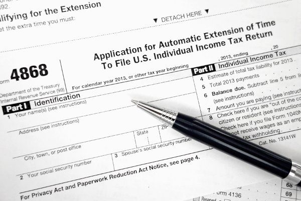 IRS Tax Form 4868 'Application for Extension of Time to File U.S. Individual Income Tax Return.' Robert D. Barnes/Getty Images