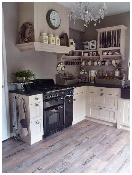 Now this is how you make a crappy little kitchen look full of character! Love it!!!