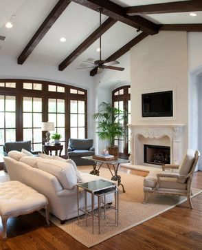 Dark Exposed Wood Beams With White Walls And Wood Floors