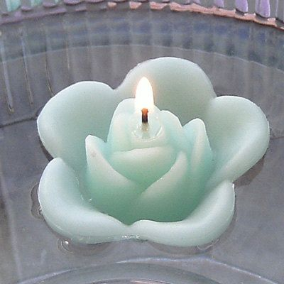 Mint green floating rose wedding candles for table centerpiece and reception decor   Keywords: #mintweddings #jevelweddingplanning Follow Us: www.jevelweddingplanning.com  www.facebook.com/jevelweddingplanning/