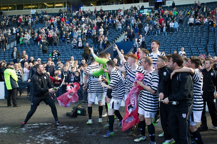 Queen's Park's players and staff celebrate promotion after the SPFL League One play-off game between Queen's Park and Clyde
