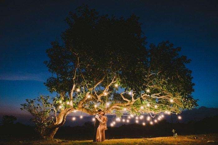 Tree with lights, romantic bridal portraits at Nusa Lembongan, Bali. DiktatPhotography. www.theweddingnotebook.com