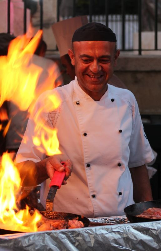 Maltese food dishes and live cooking by Maypole.