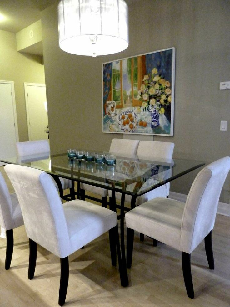 Iron with glass top dining table accented with neutral for Low back parsons dining chair