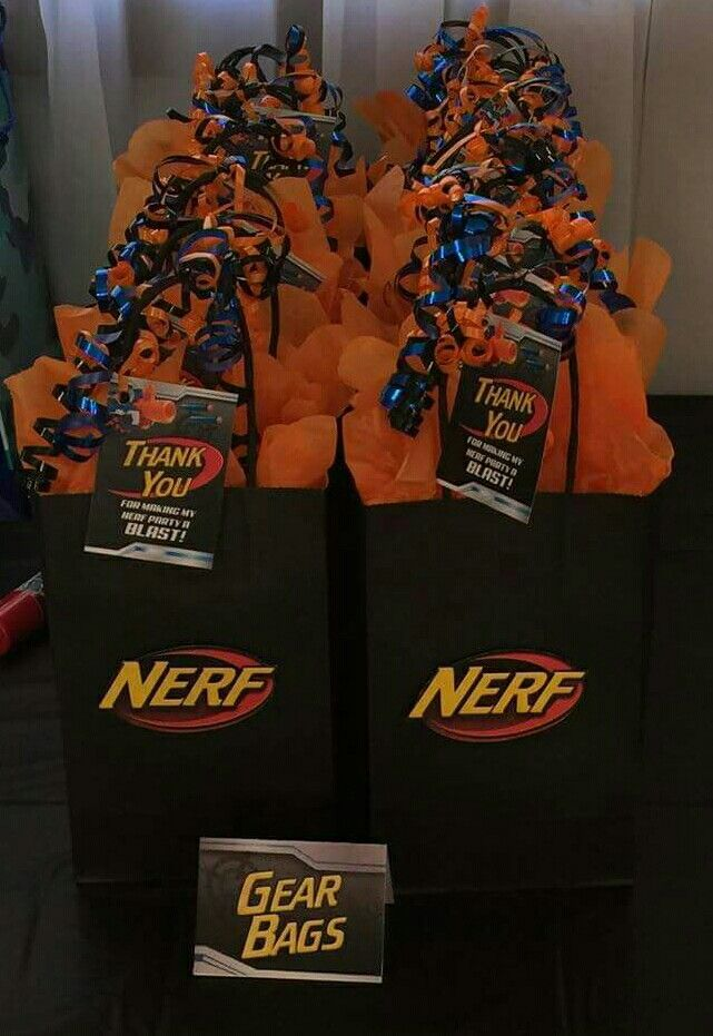 Nerf Birthday Party #Party Favor Bags Nerf logo cut out and pop dotted onto bags found at Michael's.