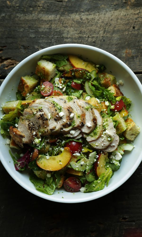 Panzanella Salad with toasted French Bread, Grilled Peaches, Cherry Tomatoes, Shaved Celery and Cucumber, Arugula, Spring Mix and Grilled Chicken in a Pesto Vinaigrette!