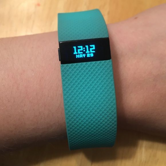 Fitbit Charge HR turquoise This is my baby. I got it a few months ago and loved it but I got an Apple Watch as a gift. It's in  good condition and is so great if you're active. Comes with charger cord, dongle, and instructions. I'm only selling it because I don't need two watches now! Fitbit Other