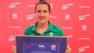 Lisa De Vanna of Australia is presented with the player of the match award