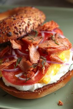 Smoked Salmon Breakfast bagel filled with cream cheese, fresh tomato, scrambled egg and smoked salmon and topped with fresh dill. It's perfection.