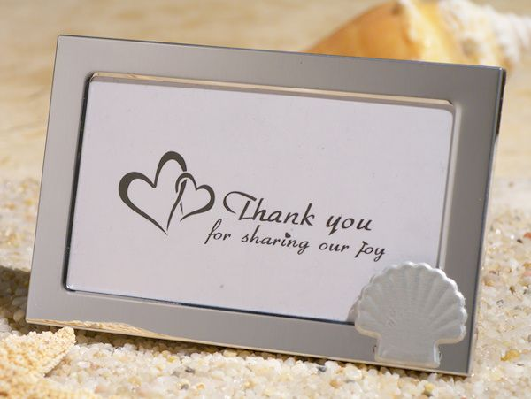 Beach Theme Metal Photo Frame Favors (Cassiani Collection 4333) | Buy at Wedding Favors Unlimited (https://www.weddingfavorsunlimited.com/beach_theme_metal_photo_frame_favors.html).