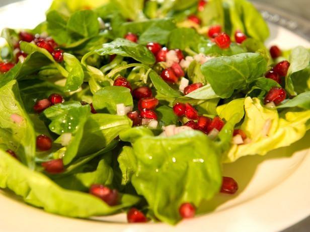 Get Butter Lettuce, Mache and Pomegranate Seeds Dressed with Champagne Vinaigrette Recipe from Cooking Channel