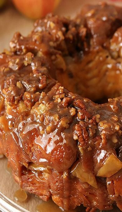 Caramel Apple Monkey Bread - Easier method. Canned biscuit dough formed in balls, rolled in brown sugar & butter, layered with apples, caramel sauce & nuts, then baked.