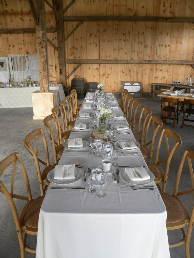 Long Harvest table with ivory linen and cross back chairs
