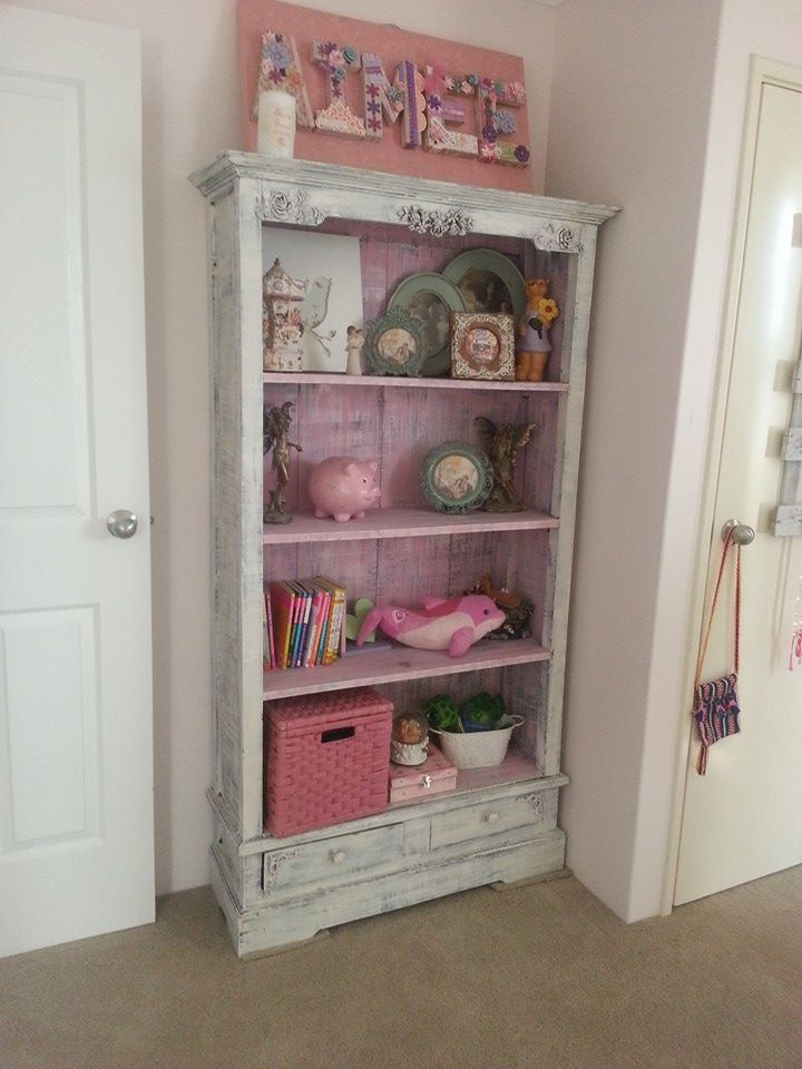 I love this bookshelf.  Very rustic.  It holds all of my girls prized processions.  The Aimee sign above was made using a canvas, lovely fabric from spotlight, heaps of embellishments and paper mache lettering.  Turned out a treat.