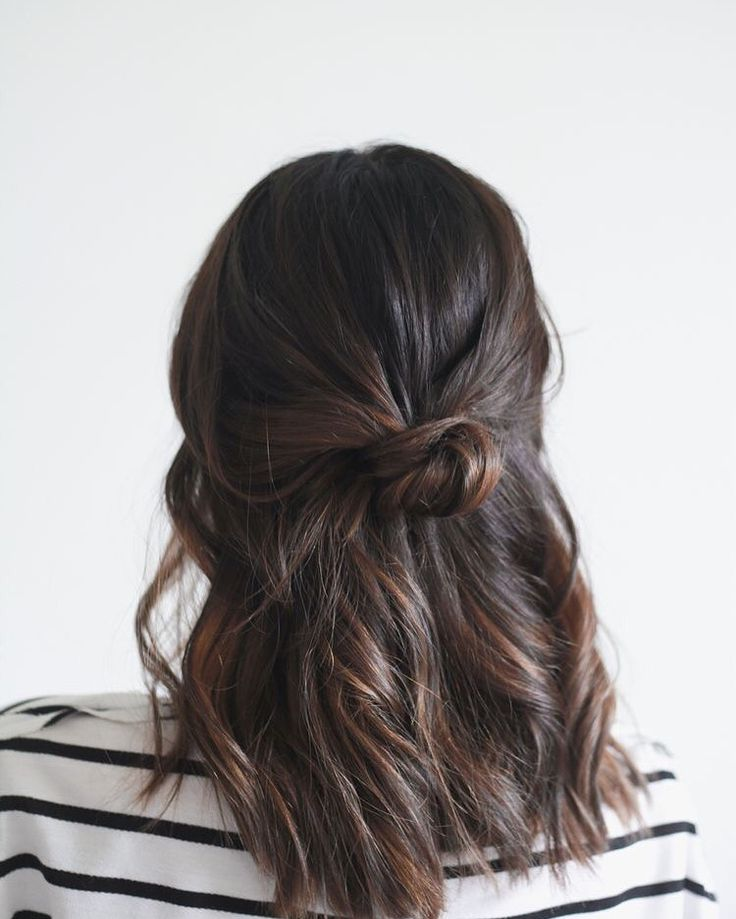This half up bun is a great way to get your hair out of your face & adds great style! #eliotjamessalon #petalumahair