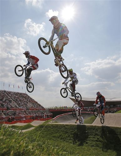 Mamas, don't let your babies grow up to be BMX riders | Cyclists compete in a BMX cycling men's quarterfinal run during the 2012 Summer Olympics in London, Thursday, Aug. 9, 2012. (Photo: Christophe Ena / AP) #NBCOlympics