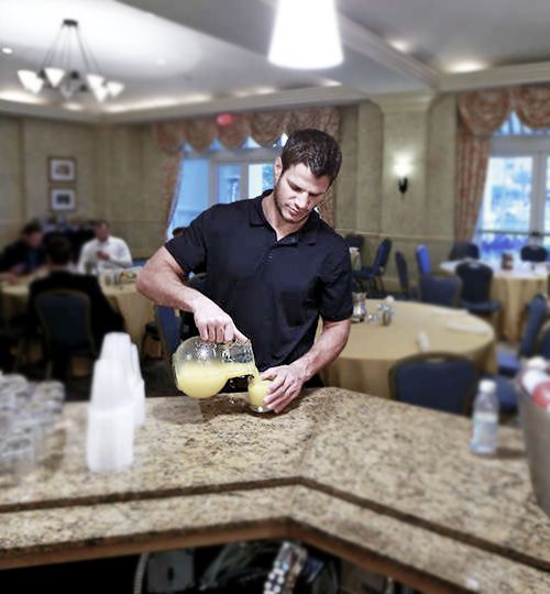 Kevin Bieksa • Vancouver Canucks • This is seriously just a pic of him pouring juice?