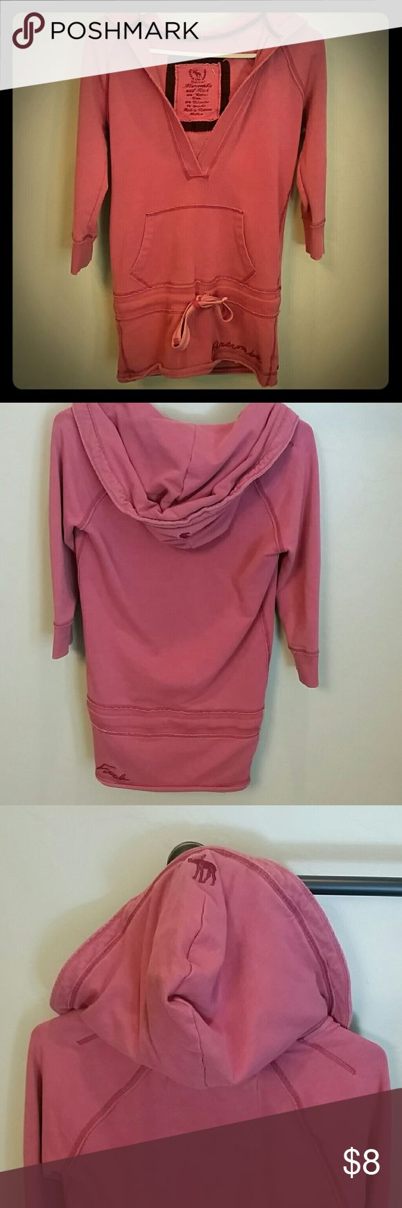 Abercrombie and Fitch hooded 3/4 sleeve pink shirt Abercrombie and Fitch hooded 3/4 sleeve pink shirt size medium. No holes or stains. Great paired with leggings or jeans. Abercrombie & Fitch Tops Sweatshirts & Hoodies