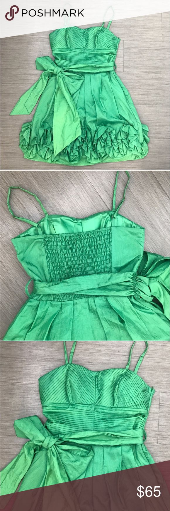"""GREEN RUFFLE DRESS WITH BIG BOW BEAUTIFUL GREEN RUFFLE DRESS. Color: different tones of green. Brand si style for Asos. Used once for a wedding. Its a size small, stretches in the back. Bust measurements is 32"""" -36"""" but stretches in the back and can fit up to size 36"""". Ask all questions before buying.                                                                    💗Condition: EUC, No flaws, no rips, holes or stains 💗Smoke free home 💗No trades/No returns 💗No modeling 💗Shipping next…"""