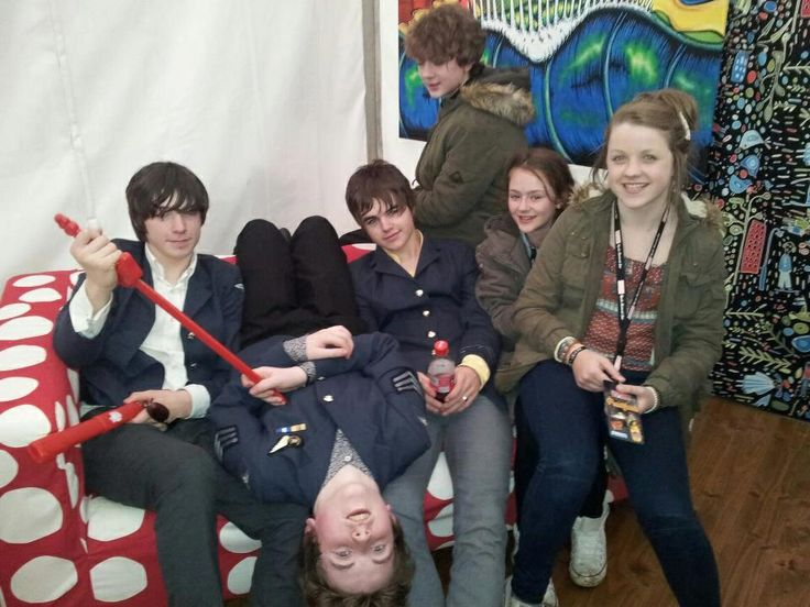The girl who's being squished is Evan's sister, Becky. -Don't know about the other girl, though. She looks a tiny bit like Pete? but maybe I'm just crazy aha.