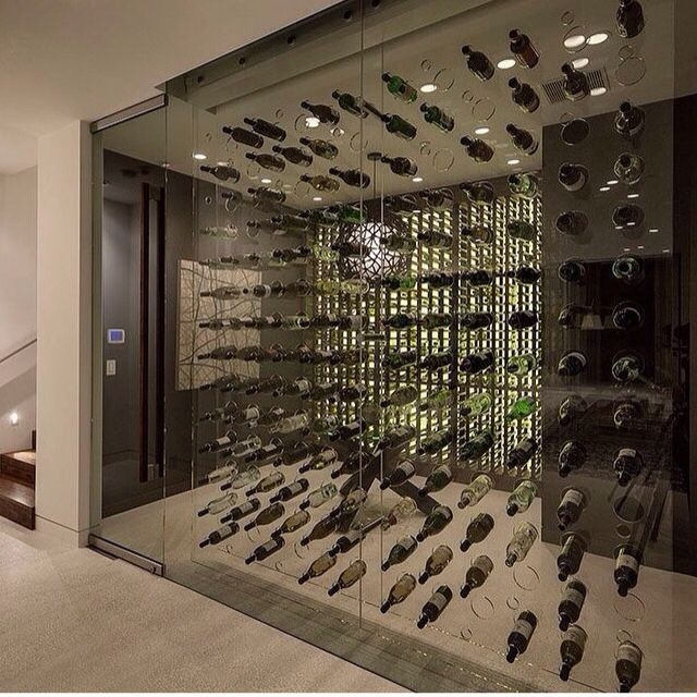 Adega open concept display on glass wall wine cellars for Wine cellar layout