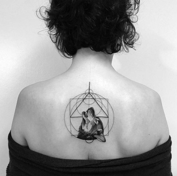 Geometric wolf tattoo on back by Daniel Matsumoto
