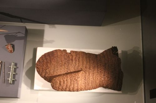 National Museum of Iceland. Mitten from Arneiðarstaðir, Fljótsdalhérad, east Iceland. Made from Nålebinding in Oslo stitch/Type IIa, the mitten was discovered in 1889 and described in 1895 by Pálmi Pálsson as being 26cm long, 12 cm wide, and from 10th century.