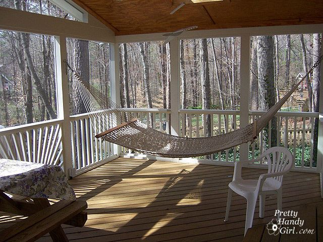 Sunny, wooded screen porch with hammock