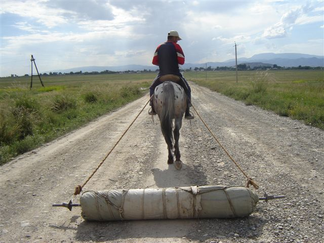 A horse helps in the compression of the Felt rug... http://www.feltrugs.co.uk/about/