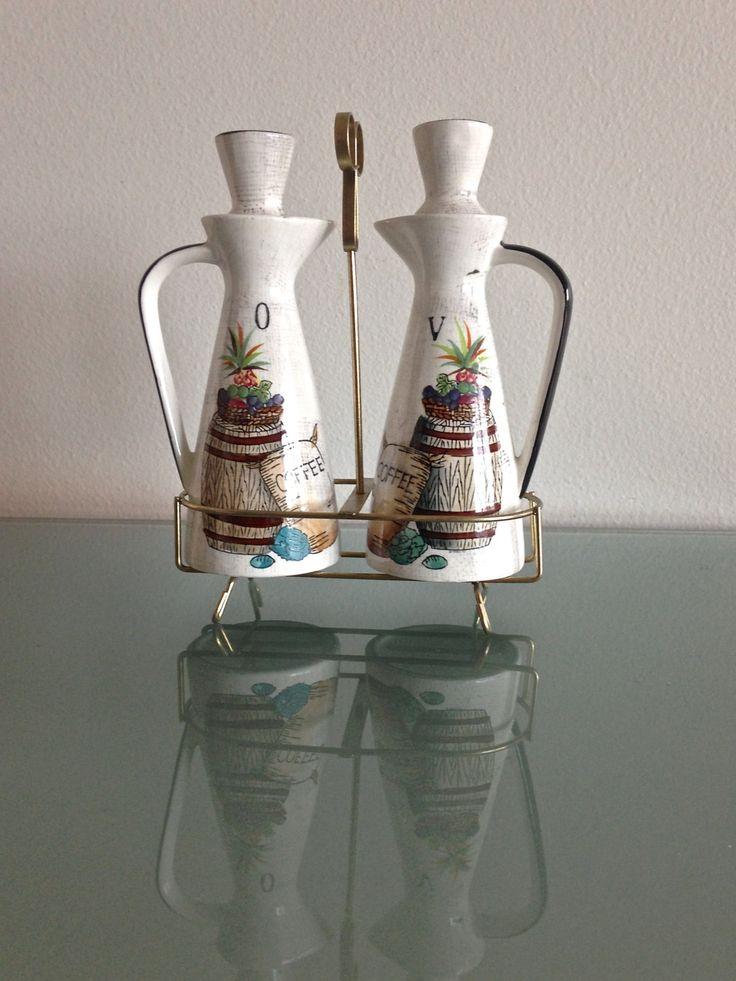 Vintage 1960s Mediterranean Cruet Set with Metal Rack // Ceramic Oil & Vinegar Decanter Set // Rustic Cottage Chic by TreatVintage on Etsy https://www.etsy.com/listing/217785200/vintage-1960s-mediterranean-cruet-set