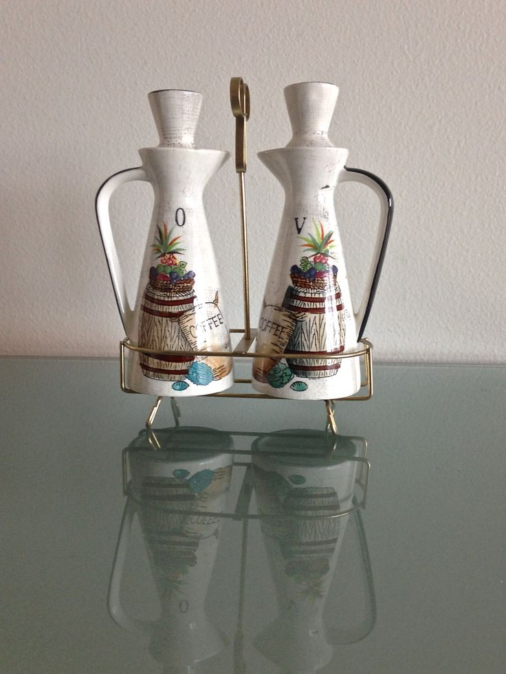 Vintage 1960s Mediterranean Cruet Set with Metal Rack // Ceramic Oil & Vinegar Decanter Set // Rustic Cottage Chic by TreatVintage on Etsy https://www.etsy.com/listing/217785200/vintage-1960s-mediterranean-cruet-set