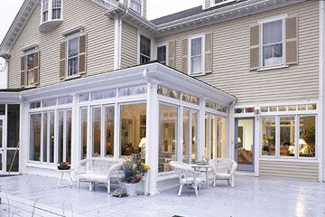 Love all the windows on this pretty sun room addition