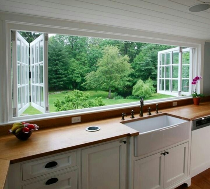 Love this... the wood counters, garbage drop, big folding windows, and a farmhouse sink!