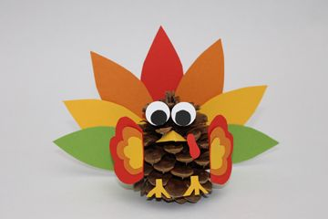 This cute Thanksgiving turkey craft comes together easily with pinecones and card stock.