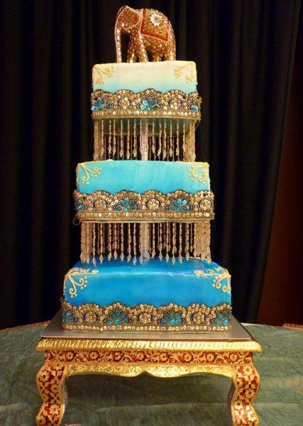 Blue Gold Square Wedding Cake, Elephant topper, indian wedding cake There's soo many cakes that I like that idk if I would want at my dream wedding!!!